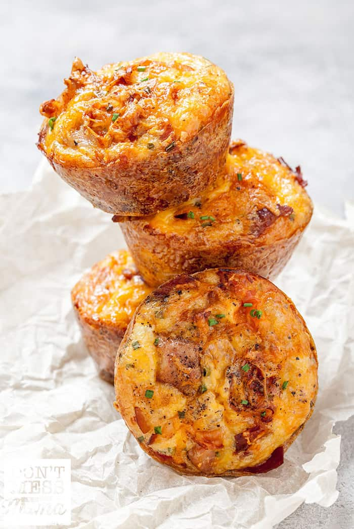 quiche cups stacked on parchment paper