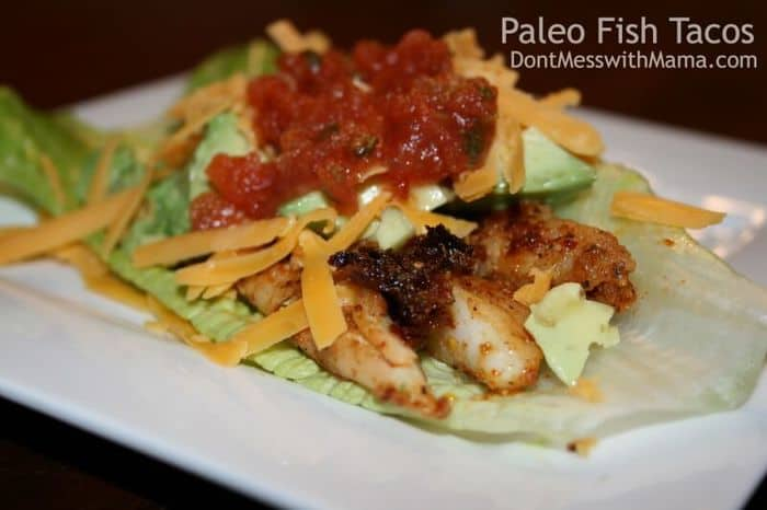A close up shot of Spicy Paleo Fish Tacos on a white plate