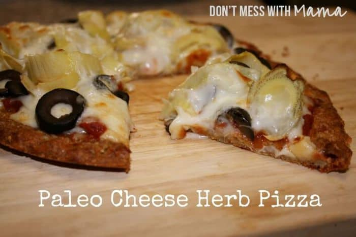A Paleo and grain free Pizza on a wooden board cut into slices