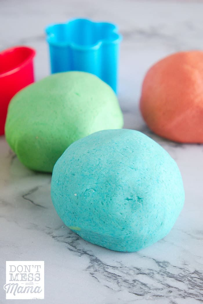 Playdough balls in different colors on a table