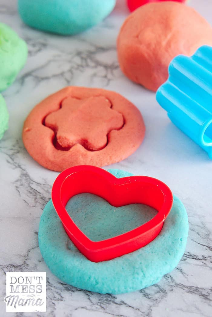 DIY Play Dough on a table with cookie cutters
