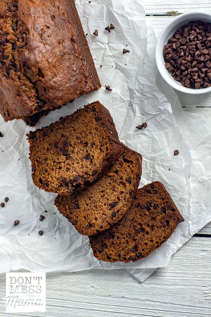 chocolate chip banana bread sliced on a table on parchment paper