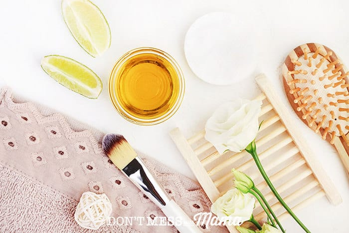 Closeup of makeup brush, face oil, flowers and other accessories for homemade acne remedies