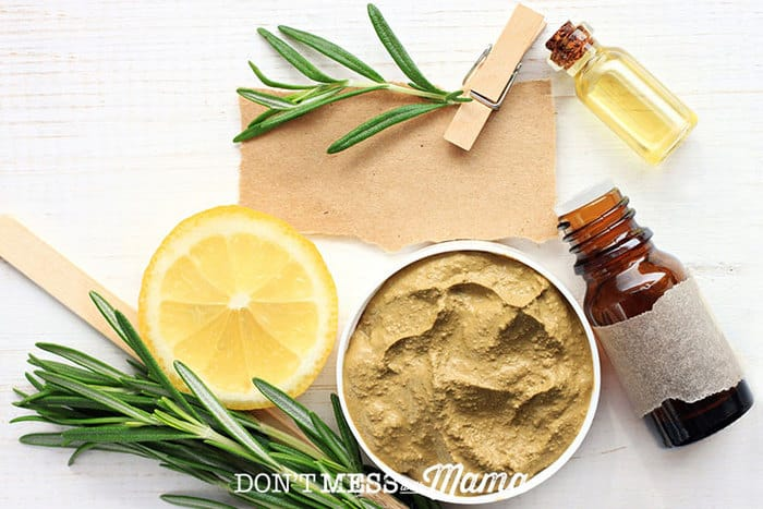 Closeup of rosemary, small bottles, face mask - all homemade acne remedies