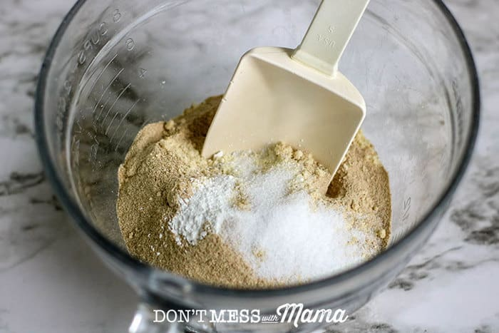 Closeup of almond flour getting added to a bowl
