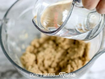 adding water to tortilla mix