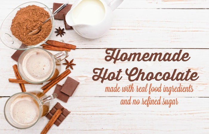 Homemade Hot Chocolate ingredients sitting on a white wooden surface