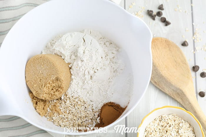 flour, oats, brown sugar in a white bowl on a table