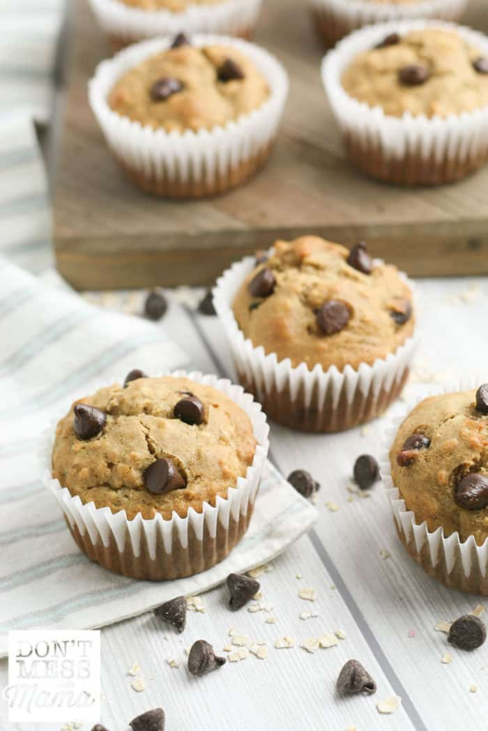 banana chocolate chip muffins on a table and cutting board