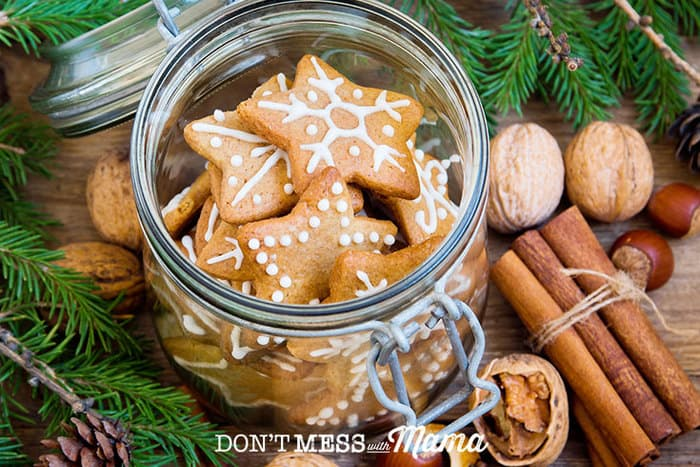 Closeup of sugar cookies in a jar with pine branches and spices