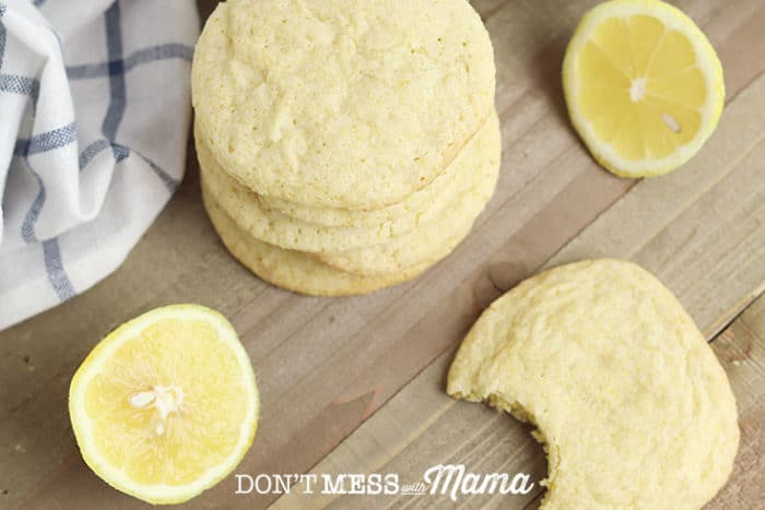 Gluten-Free Lemon Cookies piled on a plate with lemon slices in the background