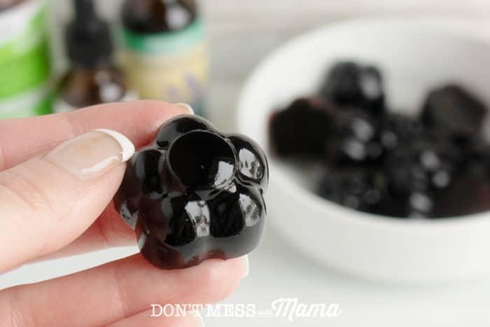 Hand holding Homemade Immune-Boosting Elderberry Gummy Snack