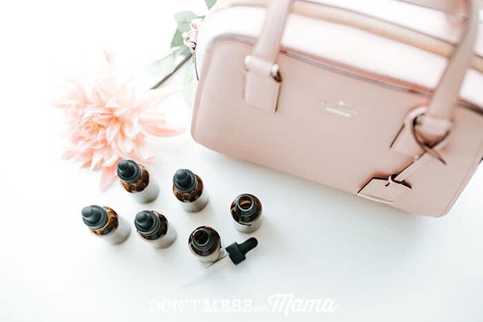 Closeup of essential oils with a purse