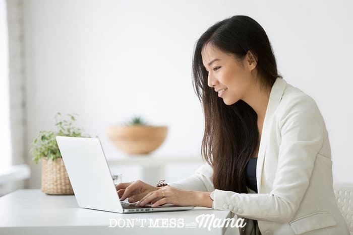 Woman sitting at a desk with a laptop