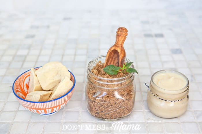 Cacao Butter in a bowl, brown sugar in a glass jar, coconut oil in a glass jar