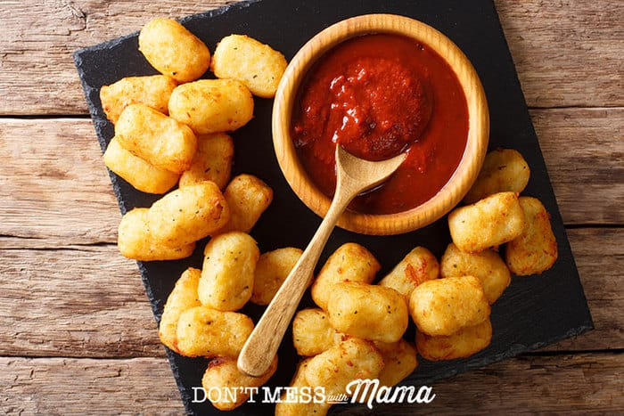 top view of tater tots on table with sauce