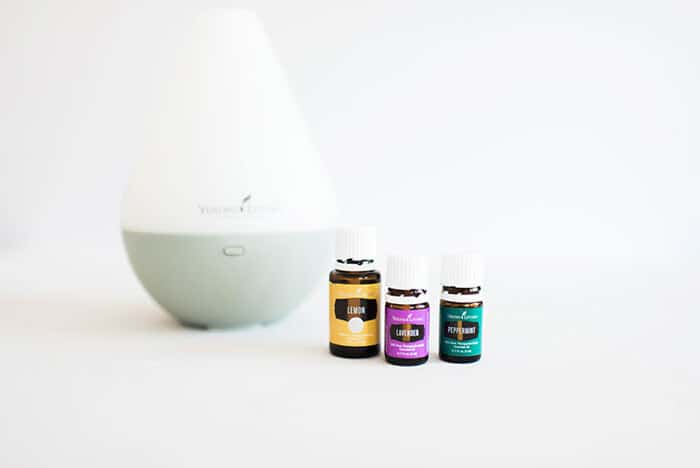 Closeup of a diffuser with bottles of essential oils