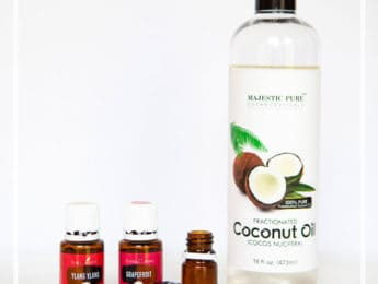 small bottles of diy perfume with a bottle of coconut oil
