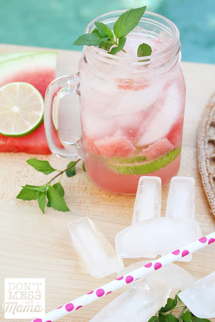 watermelon mojito in a glass with ice and mint on a table