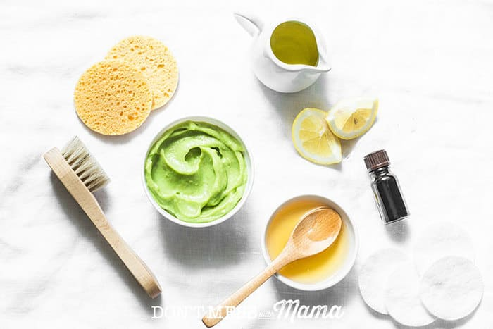 Closeup of honey, avocado and ingredients to make DIY face masks