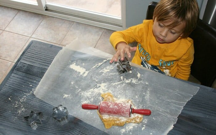 A photo of a child making Paleo Sugar Cookies