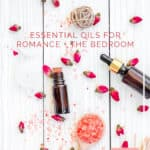 2 bottles of essential oils on white table