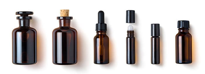 a row of brown bottles for essential oils