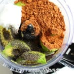 cocoa powder and avocado in a blender