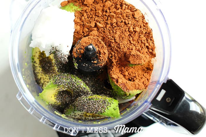 cocoa powder, avocados, chia seeds, coconut oil in a food processor