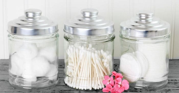 cotton balls and q tips in jars