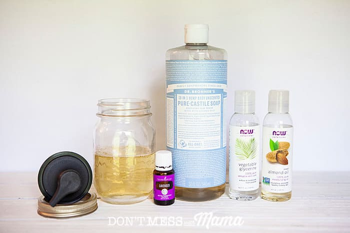 Closeup of mason jar, castile soap, vegetable glycerin and almond oil