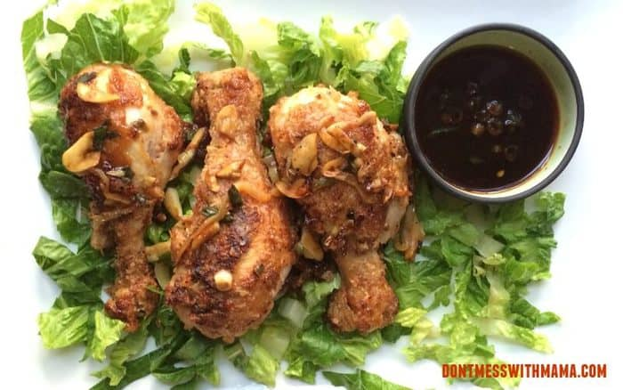AN overhead shot of Paleo Chinese Salt and Pepper Chicken on top of salad