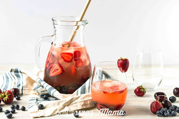 A red sangria recipe in a glass with fruit