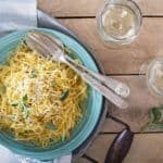 Spaghetti Squash pasta Aglio E Olio in a blue bowl on a wooden surface