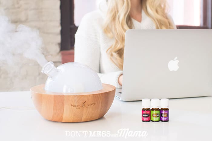 diffuser on a desk with essential oils