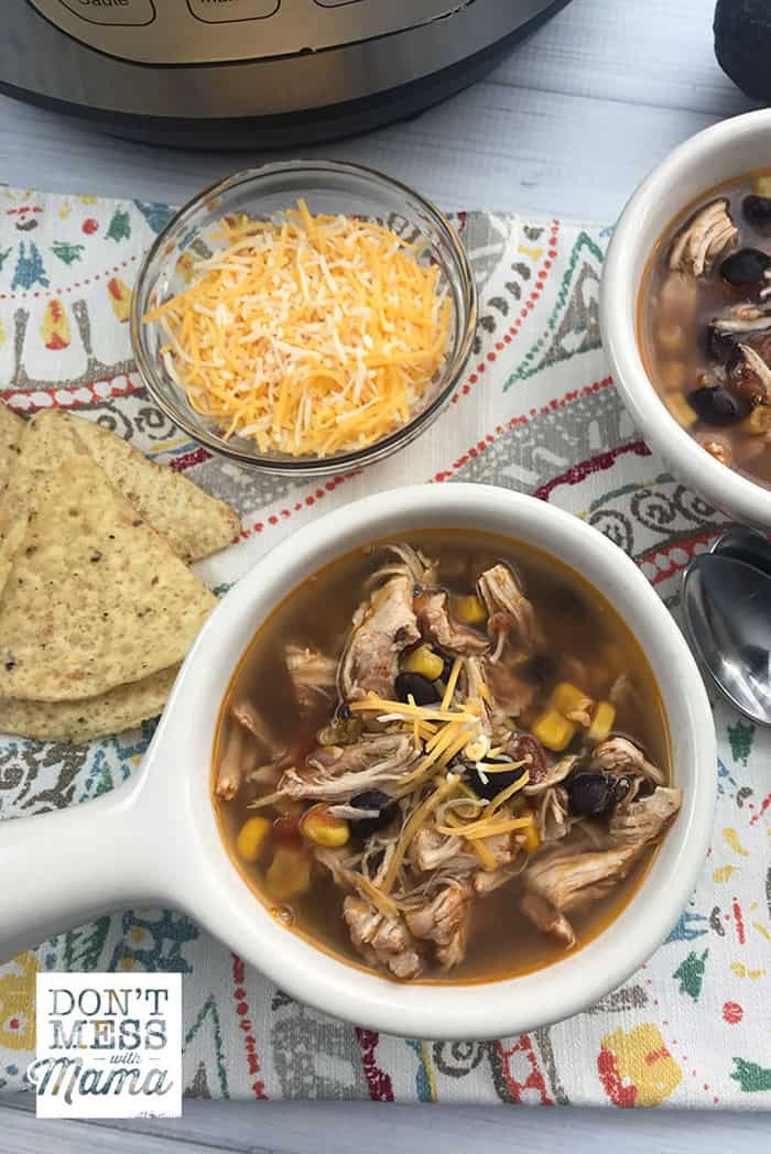 Close up of Instant Pot Chicken Tortilla Soup in a white bowl