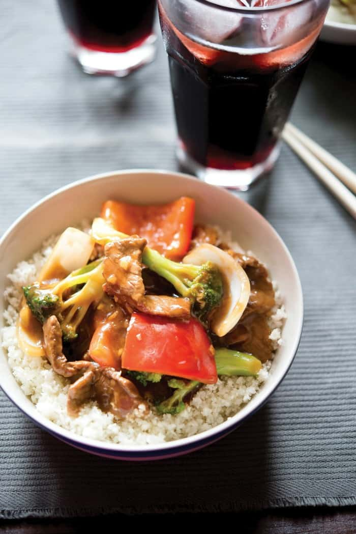 A bowl of Paleo Ginger Beef Stir Fry with rice