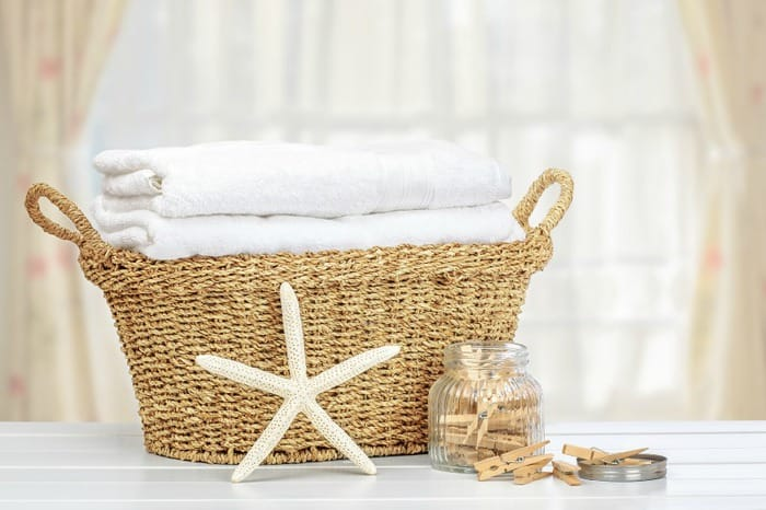 Basket of fresh towels with clothes pins in the background