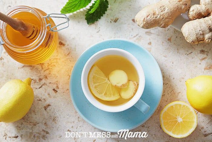 Honey, lemons on a table with a tea cup