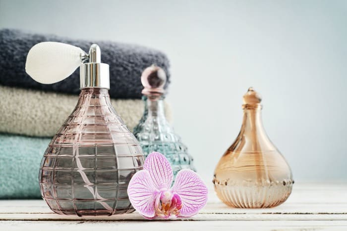 A side shot of glass perfume bottles filled with poo spray