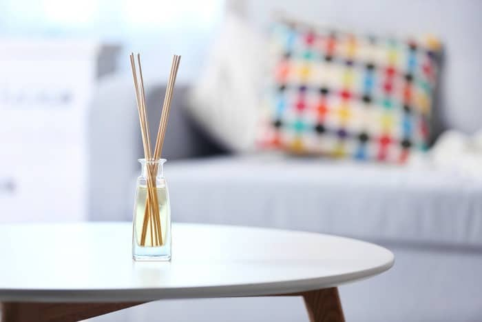 A photo of a DIY reed diffuser on a table
