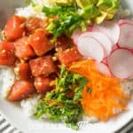 A side shot of a white Ahi Tuna Poke Bowl