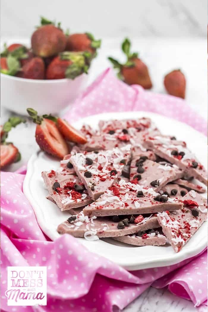Closeup of Paleo dark chocolate strawberry bark on a white plate