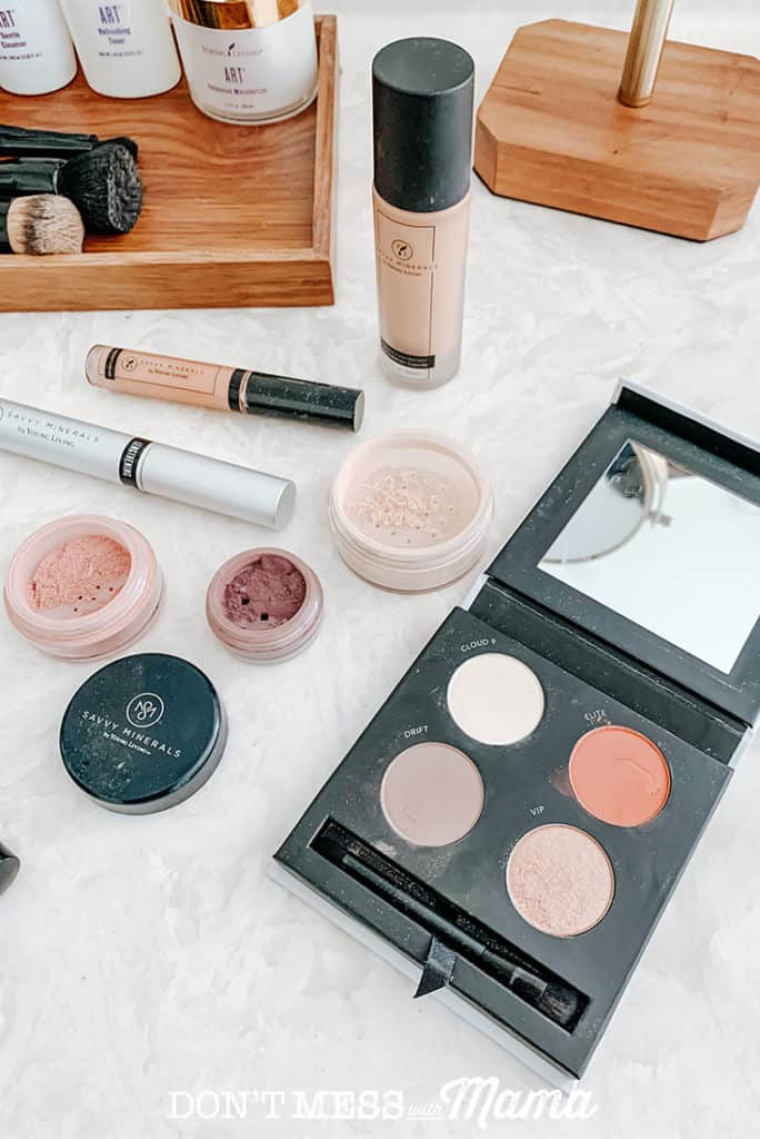 Savvy Minerals makeup eye shadow palette, loose eye shadow and blush powder on a bathroom counter