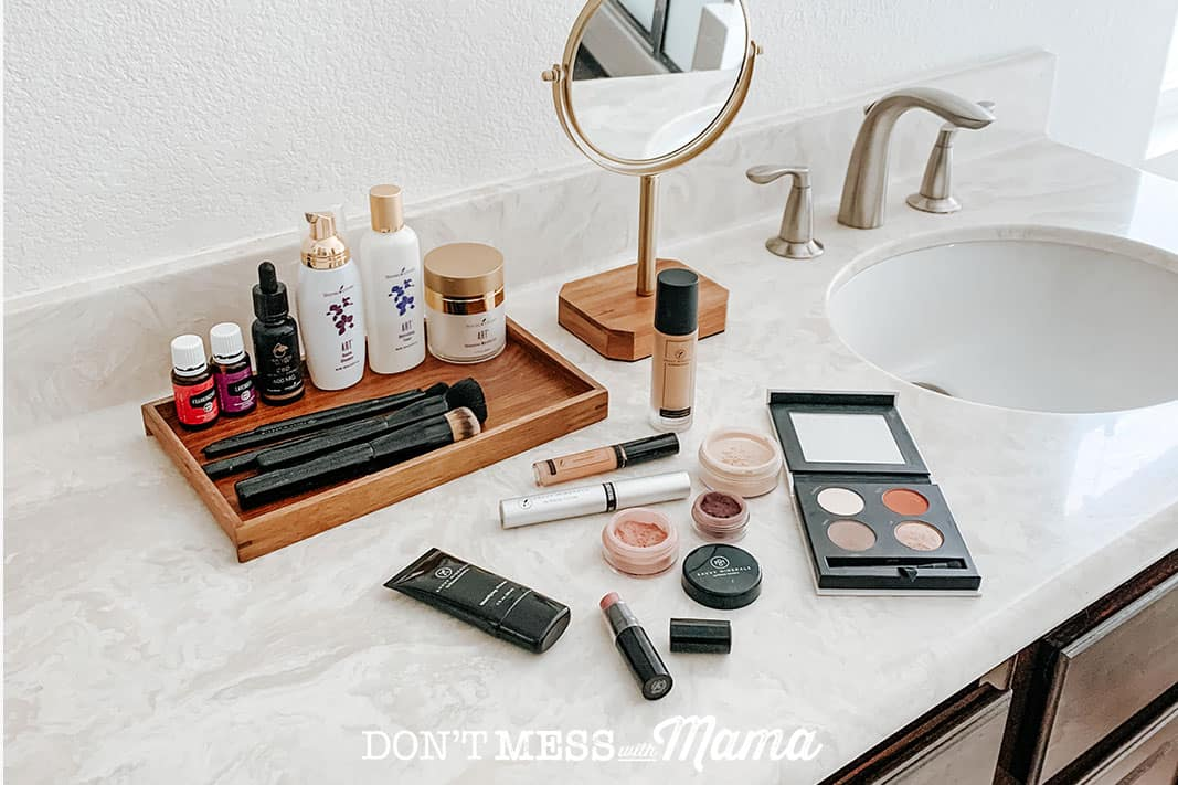 Savvy minerals makeup like lipstick, eye shadow and makeup brushes on a bathroom counter