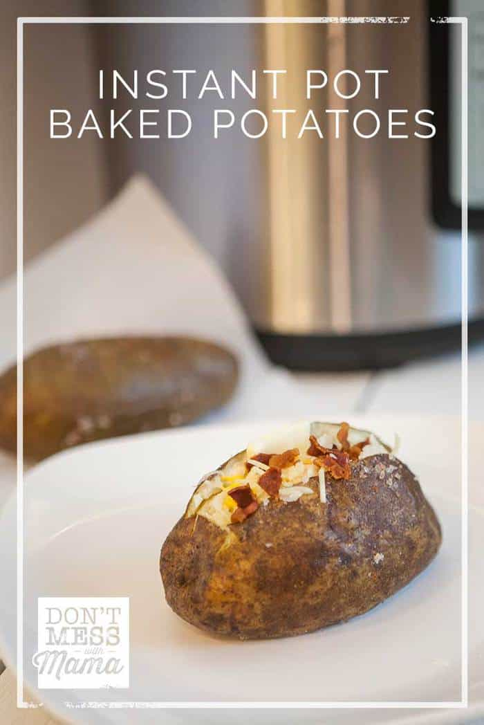 Instant Pot Baked Potatoes on a white plate cut open and topped with bacon