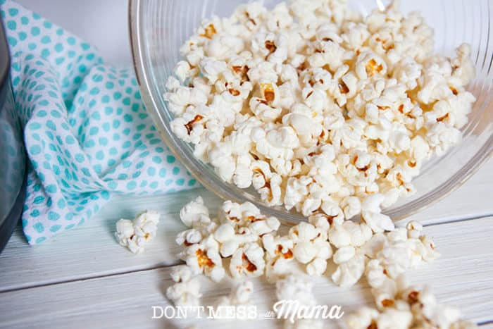 Instant Pot Popcorn in a glass bowl on it's side