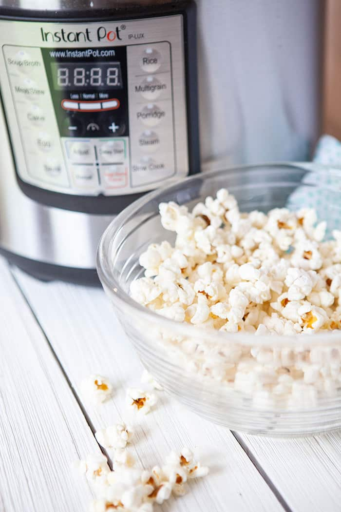 Closeup of popcorn in a bowl in front of an Instant Pot