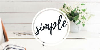 Photo of flowers on a counter with a link to simple and minimalist living tips