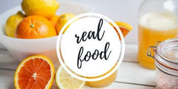 Photo of oranges on a counter with a link to real food recipes on the blog